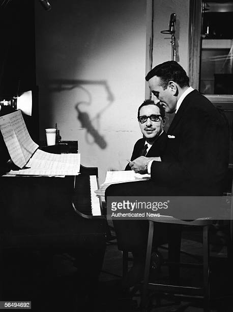 American composer Harold Arlen and American singer Tony Bennett rehearse one of Arlen's songs during a recording session for the TV special 'The...