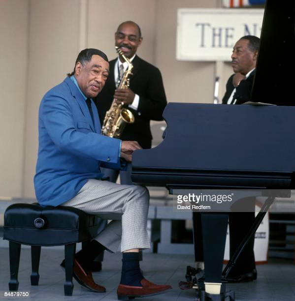 American composer, pianist and bandleader Duke Ellington performs live on stage with saxophonist Johnny Hodges at the Newport Jazz Festival in...