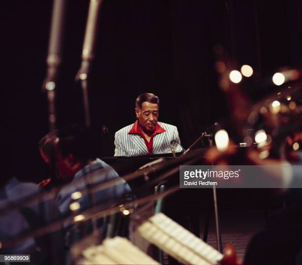 American composer, pianist and bandleader Duke Ellington performs live on stage with his orchestra at the Hammersmith Odeon in London on 21st October...