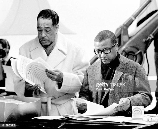 American composer, pianist and bandleader Duke Ellington stands on left with jazz composer and arranger Billy Strayhorn during the recording of the...