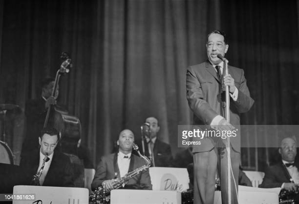 American composer pianist and jazz musician Duke Ellington pictured on stage with the Duke Ellington Orchestra at the Hammersmith Odeon in London on...