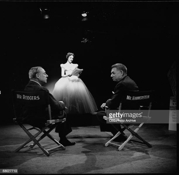 American composer Richard Rodgers and American lyricist Oscar Hammerstein II sit in directors chairs while British actress and singer Julie Andrews...