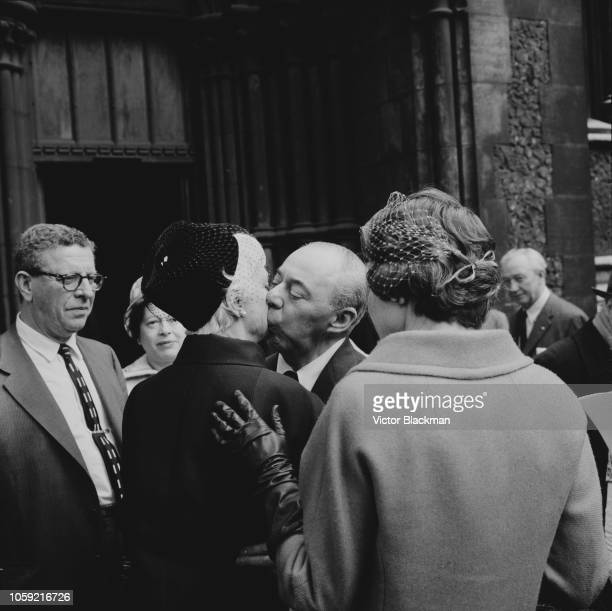 American composer Richard Rodgers kisses Australian interior designer and decorator Dorothy Hammerstein at a memorial service for her late husband...