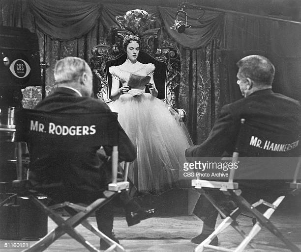 American composers Richard Rodgers and Oscar Hammerstein II watch British actress Julie Andrews read her script on the set of the CBS Television...
