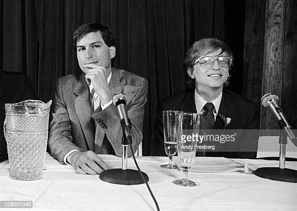 American computer magnates Steve Jobs cofounder of Apple Computer Inc and Bill Gates cofounder of Microsoft as they take questions at a press...
