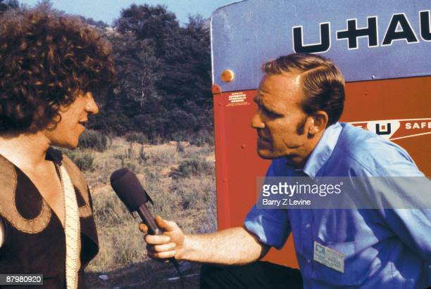 American concert producer promoter Michael Lang answers questions from an unidentified reporter from ABC News at the Woodstock Music and Arts Fair in...