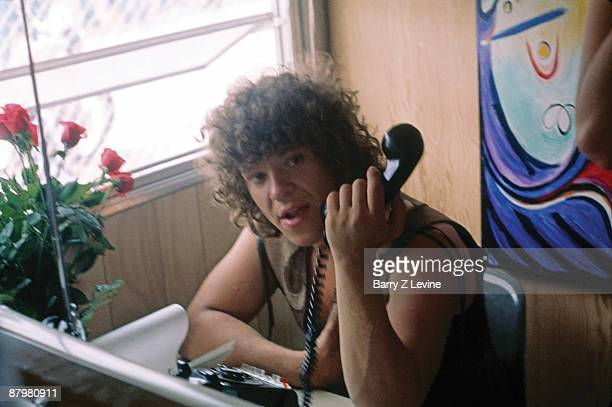 American concert producer promoter Michael Lang holds a telephone in an office at the Woodstock Music and Arts Fair in Bethel New York August 15 17...