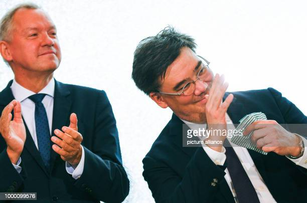 American conductor Alan Gilbert is introduced by Lutz Marmor the director of North German Radio at a press conference in the Elbphilharmonie in...