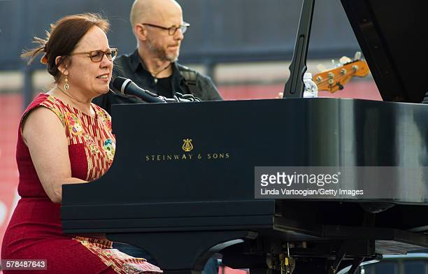 American Country and Folk musician Iris DeMent plays piano with her band with at the Lincoln Center Out of Doors Americanafest NYC on Hearst Plaza...