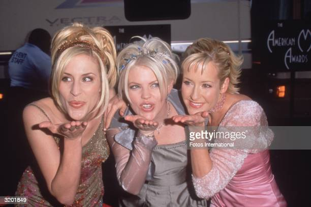 American country group The Dixie Chicks blow a kiss to photographers at the 1999 American Music Awards where they had been named Favorite New Country...