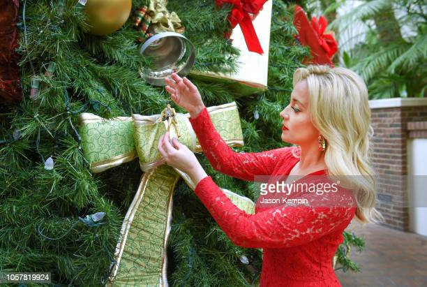 American country music artist and Emmynominated television personality Kellie Pickler is seen hanging a Christmas ornament at the Gaylord Opryland...