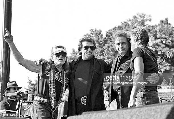 American country music group the Highwaymen from left Willie Nelson Waylon Jennings Johnny Cash and Kris Kristofferson embrace onstage at Central...