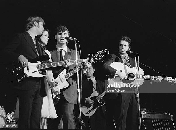 American country music performer Merle Haggard performs on stage with his band, 1970.