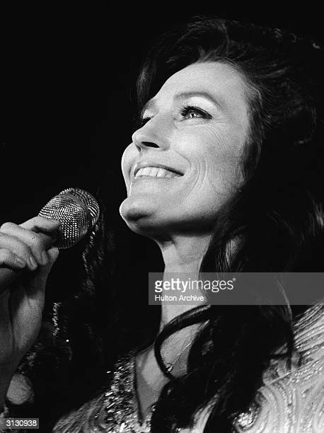 American country music singer and guitarist Loretta Lynn performs on stage in California 1972