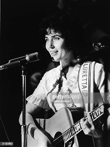 American country music singer and guitarist Loretta Lynn performs on stage at the Grand Ole Opry 1960s
