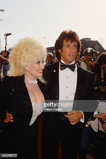 American country music singer and songwriter Dolly Parton and actor director screenwriter and producer Sylvester Stallone attend the premiere of the...