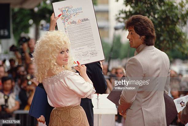 American country music singer and songwriter Dolly Parton and actor director screenwriter and producer Sylvester Stallone receive stars on the...