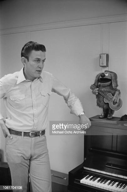 American country music singer and television host Jimmy Dean in his office USA November 1964 He is being interviewed by Jim Delehant for 'Country...