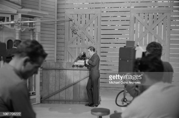 American country music singer and television host Jimmy Dean talks to Rowlf the Dog on the set of 'The Jimmy Dean Show' USA 13th November 1964 Rowlf...