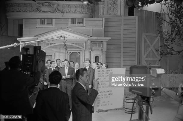 American country music singer and television host Jimmy Dean rehearses with the Chuck Cassey singers on the set of 'The Jimmy Dean Show' USA 13th...