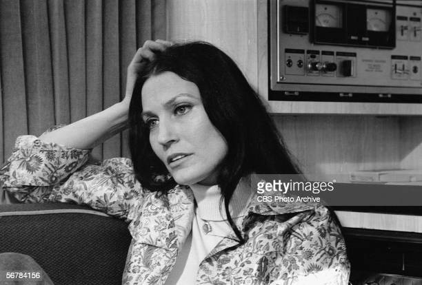 American country music singer Loretta Lynn rests her head on her hand and reclines on a couch near some audio equipment February 24 1975