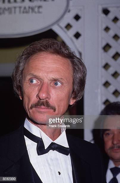 American country music singer Mel Tillis wearing a tuxedo looks to the side while attending the 18th Annual Academy Of Country Music Awards at...