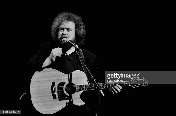 American Country musician Don Schlitz plays guitar as he performs onstage at the Grand Ole Opry, Nashville, Tennessee, December 1, 1993.