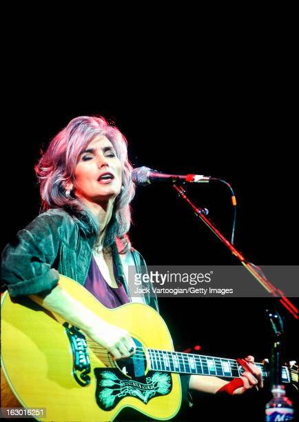 American country musician Emmylou Harris leads her band Spyboy at the Roots of American Music Festival, Damrosch Park Bandshell, Lincoln Center...