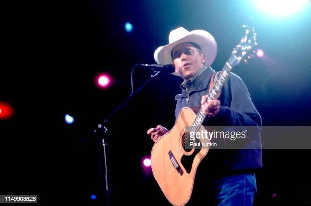 American Country musician George Strait plays guitar as he performs onstage at the Tweeter Center Tinley Park Illinois May 5 2001