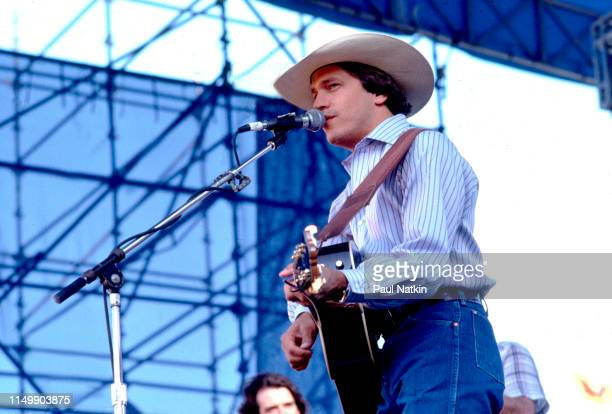 American Country musician George Strait plays guitar as he performs onstage at Chicagofest Chicago Illinois August 30 1985