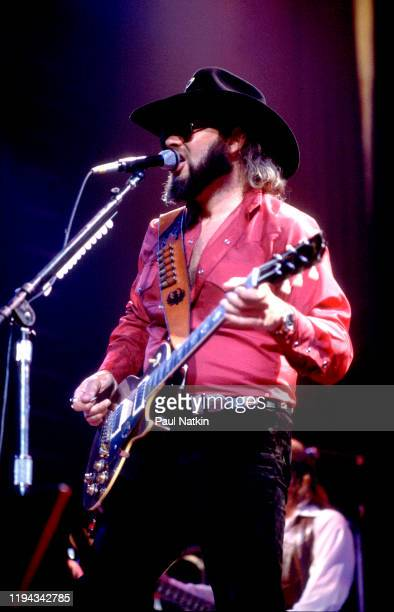 American Country musician Hank Williams Jr plays guitar as he performs onstage at an unspecified venue, Birmingham, Alabama, May 7, 1985.