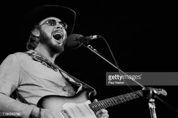 American Country musician Hank Williams Jr plays guitar as he performs onstage at an unspecified venue, Oakbrook, Illinois, November 27, 1977.