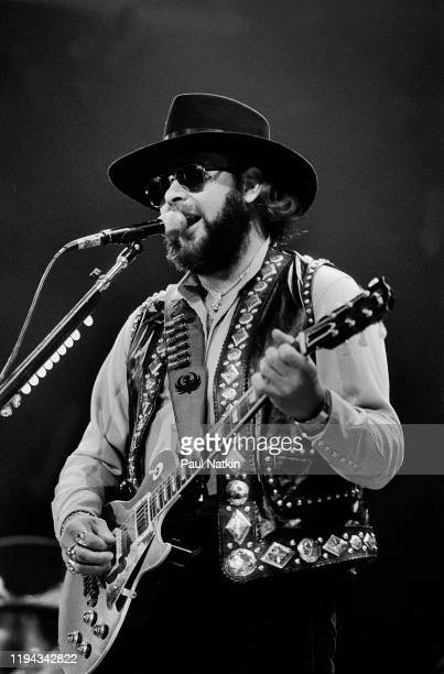 American Country musician Hank Williams Jr plays guitar as he performs onstage at an unspecified venue Fresno California April 19 1986