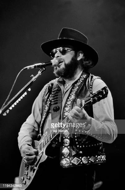 American Country musician Hank Williams Jr plays guitar as he performs onstage at an unspecified venue, Fresno, California, April 19, 1986.