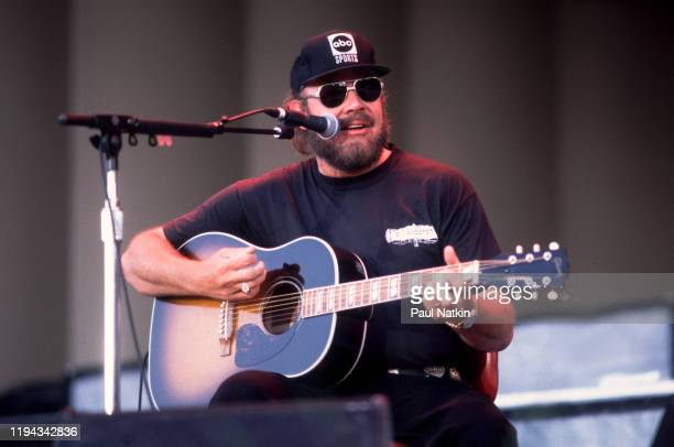 American Country musician Hank Williams Jr plays guitar as he performs onstage at the Petrillo Bandshell, Chicago, Illinois, June 25, 1996.