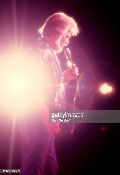American Country musician Kenny Rogers performs onstage at Nassau Coliseum, Uniondale, New York, August 29, 1985.
