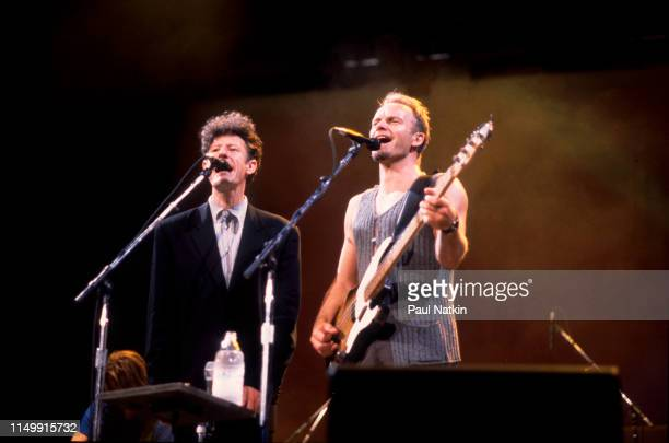 American Country musician Lyle Lovett performs with British musician Sting on bass guitar at the Aire Crown Theater Chicago Illinois February 11 1991