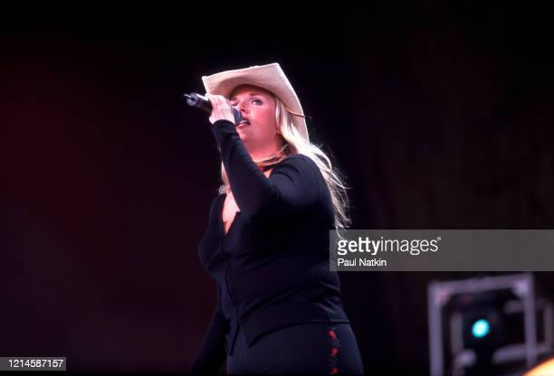 American Country musician Tricia Yearwood performs onstage, during the Farm Aid benefit concert, Manassas, Virginia, September 12, 1989.
