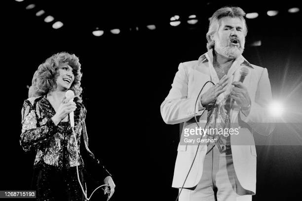 American Country musicians Dottie West and Kenny Rogers perform together onstage at Nassau Coliseum, Uniondale, New York, September 26, 1980.