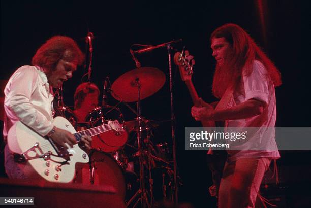 American country rock band Poco perform on stage, London, 1976. L-R Paul Cotton, George Grantham, Timothy B. Schmit.