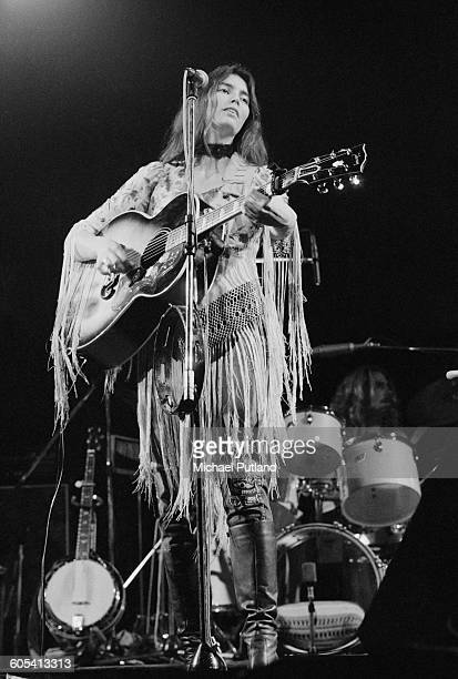 American country singer and musician Emmylou Harris performing on stage, London, 17th November 1975.