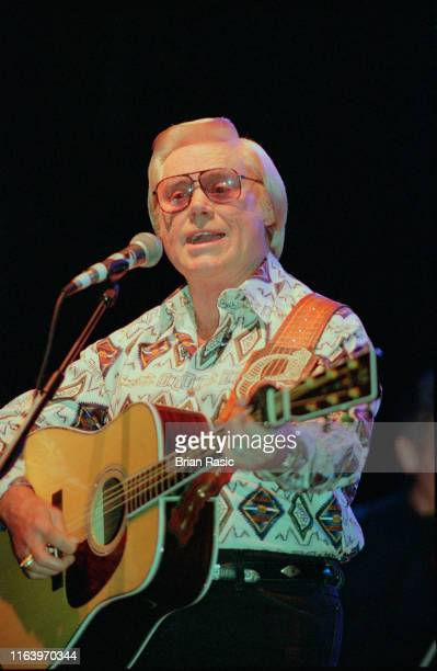 American country singer and musician George Jones performs live on stage at Hammersmith Apollo in London in September 1995