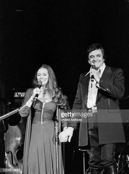 American country singer and song writer Johnny Cash and his wife June Carter Cash performing at Hamburg, Germany, circa 1981.
