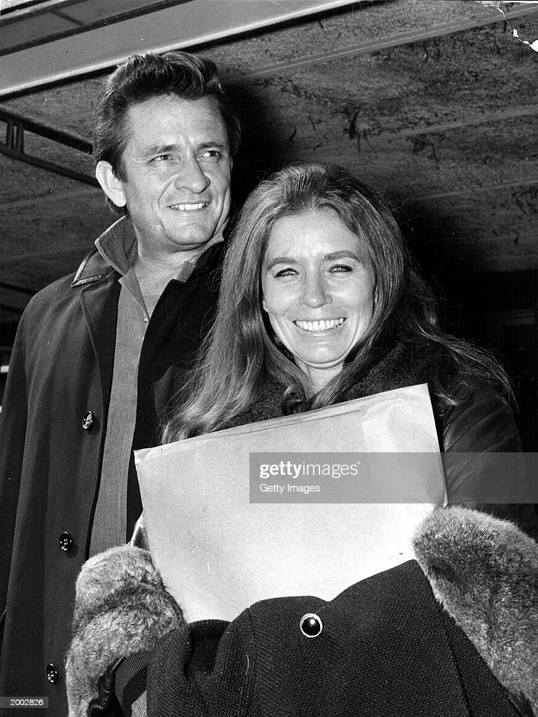 American country singer and songwriter Johnny Cash (L) and his wife June Carter Cash of the Carter Family group arrive May 1, 1968 at London Airport in London, United Kingdom. June Carter Cash, 73, died May 15, 2003 of complications from heart surgery.