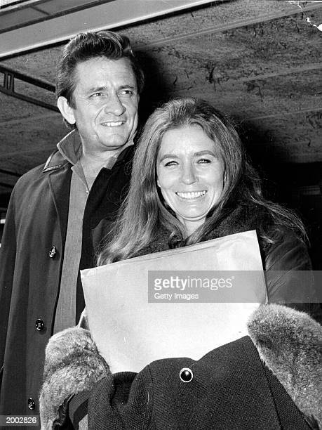 American country singer and songwriter Johnny Cash and his wife June Carter Cash of the Carter Family group arrive May 1 1968 at London Airport in...