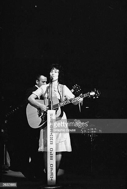American country singer and songwriter Loretta Lynn performs on stage at the Grand Ole Opry Nashville Tennessee early 1960s