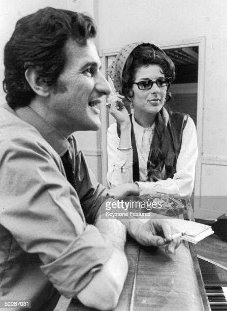American country singer Bobbie Gentry discusses ideas for her new BBC TV show with director Stanley Dorfman July 1968