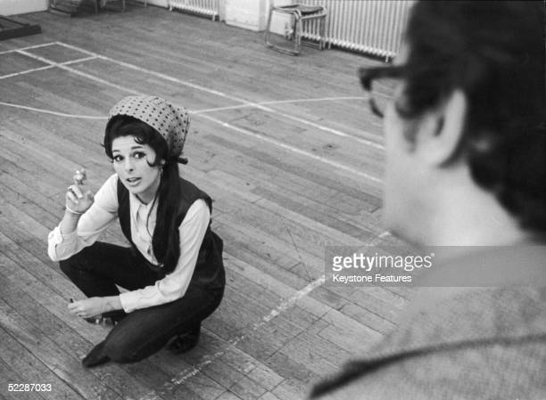 American country singer Bobbie Gentry discusses ideas for her new BBC TV show with musical director John Cameron July 1968