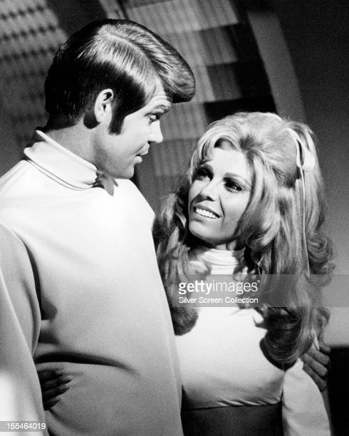 American country singer Glen Campbell with guest Nancy Sinatra in an episode of the TV show 'The Glen Campbell Goodtime Hour' circa 1969