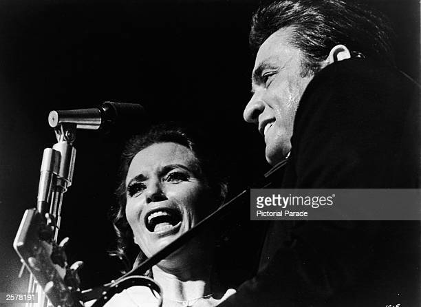 American country singer Johnny Cash performs on stage with his wife June Carter Cash September 1979